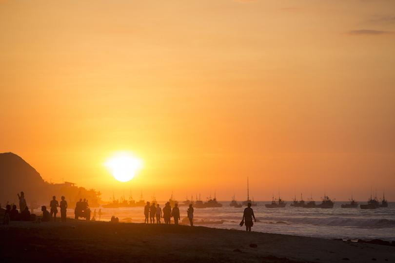 People walking on the beach of Mancora