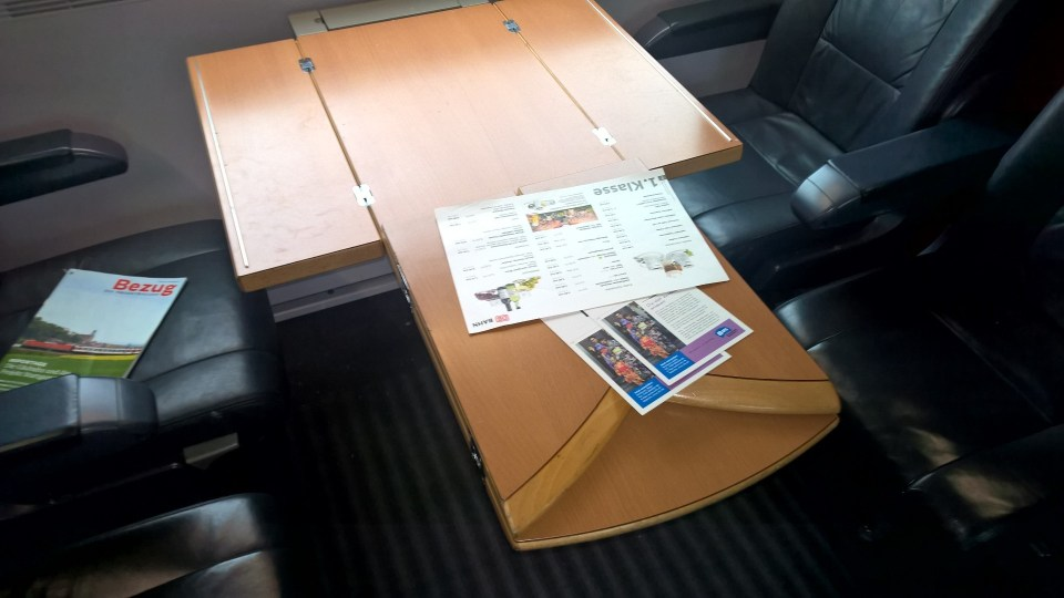 Large tables are available in compartment and open seating cars