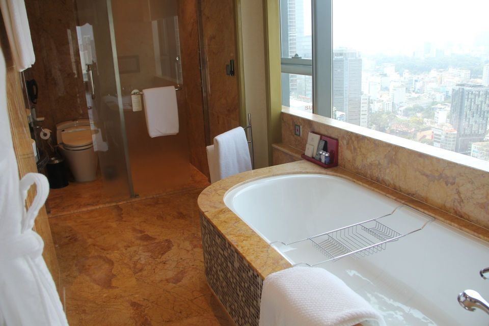 The Reverie Saigon Grand Deluxe Room Bathroom
