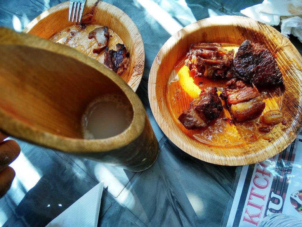Rice Beer with Roasted Pork In Hornbill Festival