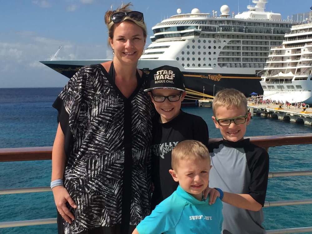 18 Top Secret Disney Fantasy Tips and Tactics  featured by top US family travel blog, Travel with a Plan: image of a family standing at port on Disney Cruise
