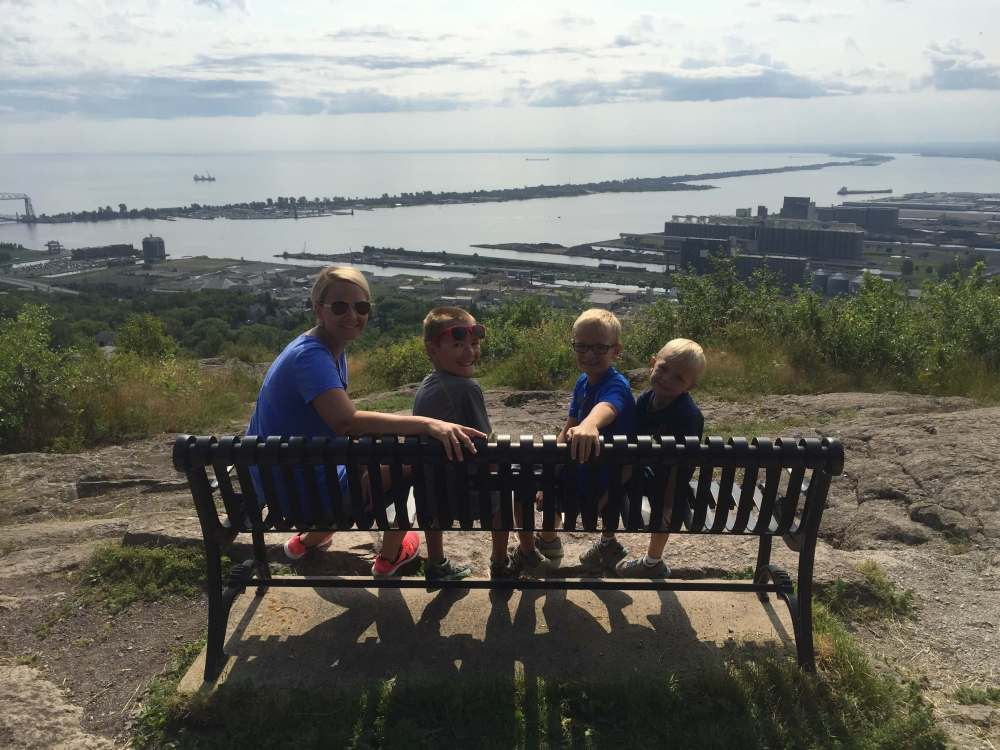 The Best Things to Do in Duluth MN with your Family featured by top US family travel blog, Travel with a Plan: image of Sitting on bench viewing Duluth Skyline