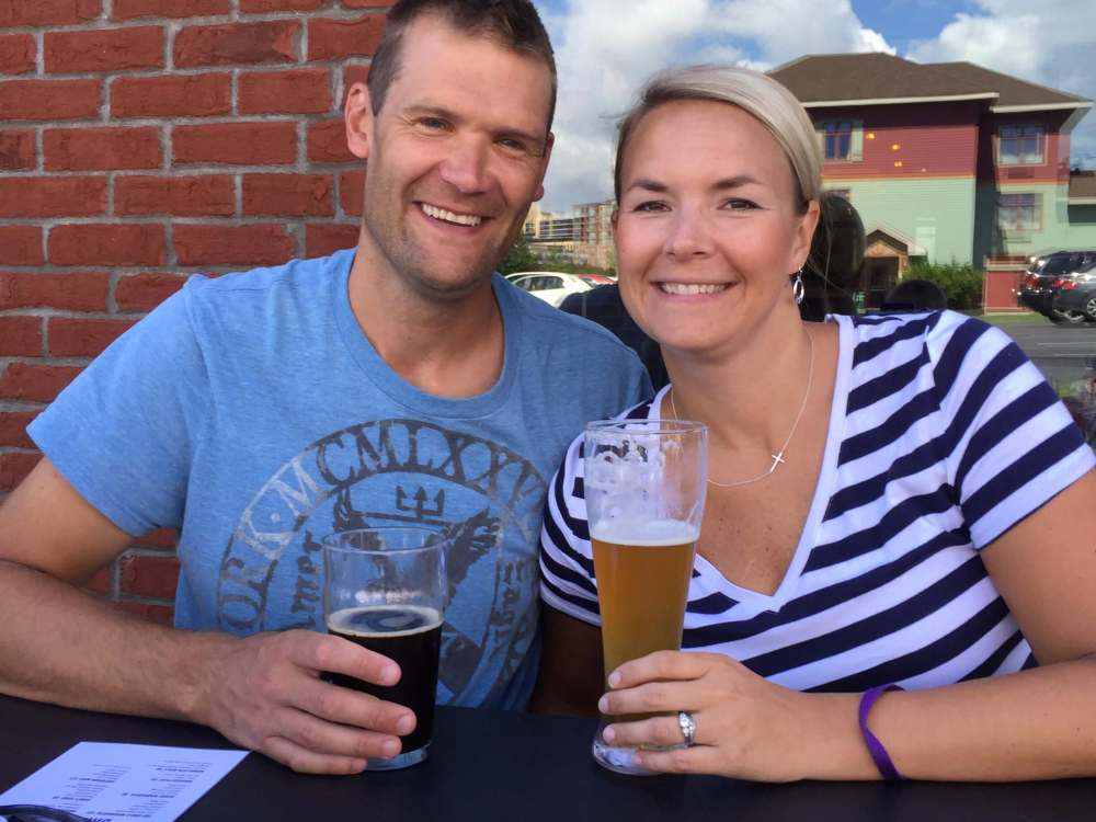 The Best Things to Do in Duluth MN with your Family featured by top US family travel blog, Travel with a Plan: image of a Husband and wife at Canal Park Brewery