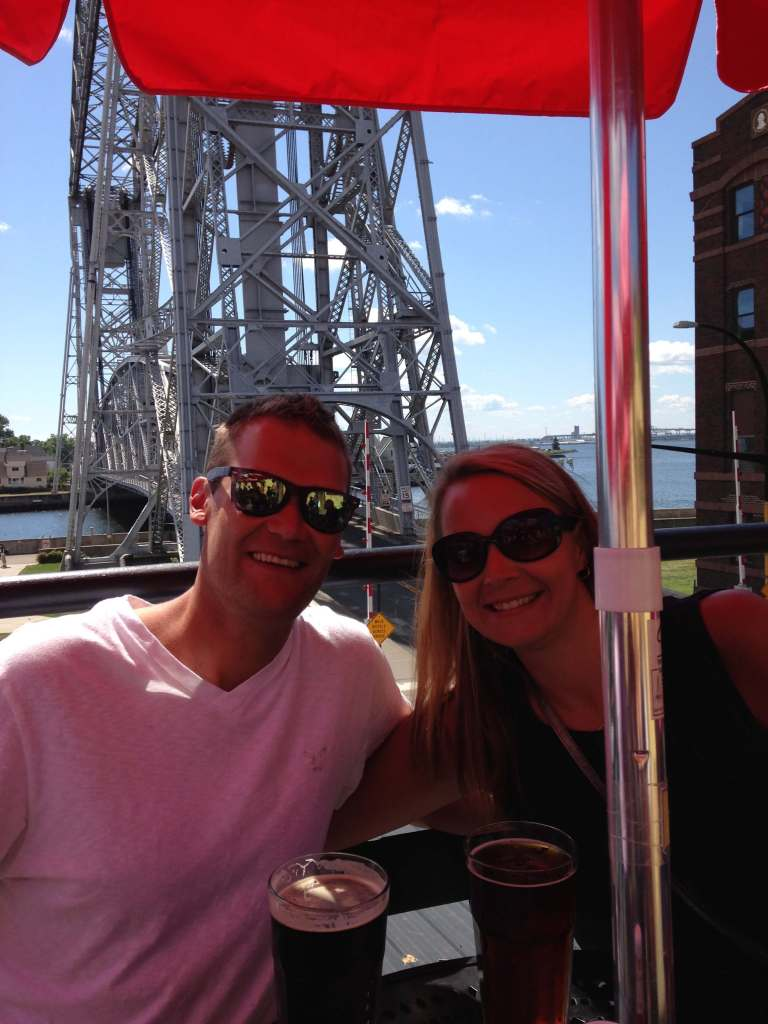 The Best Things to Do in Duluth MN with your Family featured by top US family travel blog, Travel with a Plan: image of a Couple eating on Grandma's patio