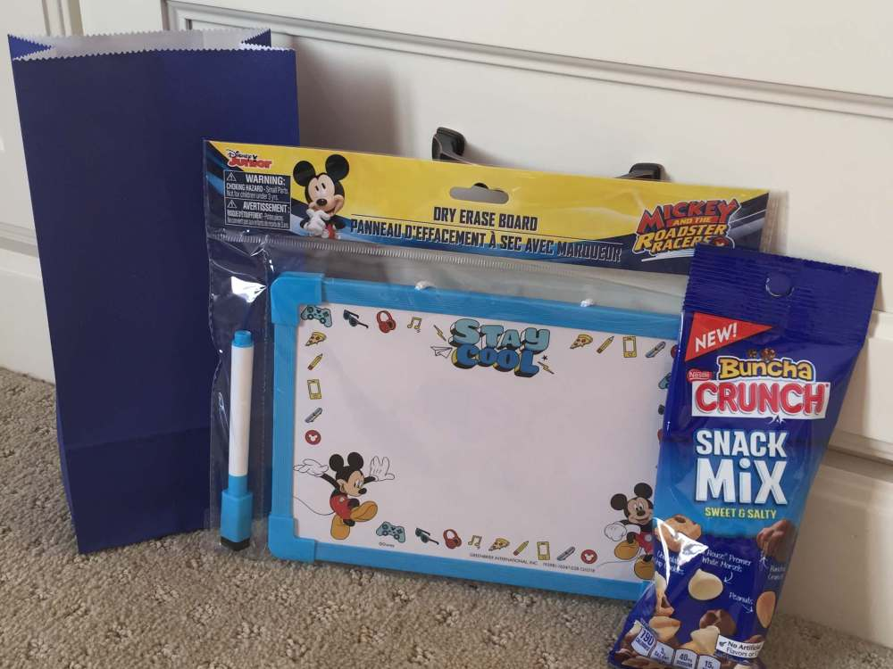Road Trip activities featured by top US family travel blog, Travel with a Plan: White board road trip activity bag