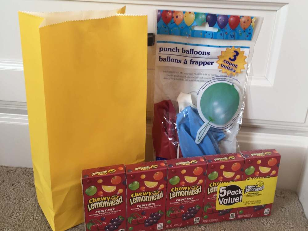 Road Trip activities featured by top US family travel blog, Travel with a Plan: Punch balloon road trip activity bag