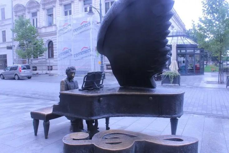 The statue of Arthur Rubinstein playing the piano on Piotrkowska street in Lodz