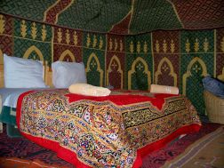 a warm bed in the camel hair tent on a cold night
