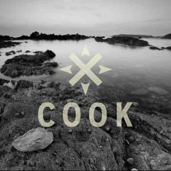 Cook Brand on the rocks and sea