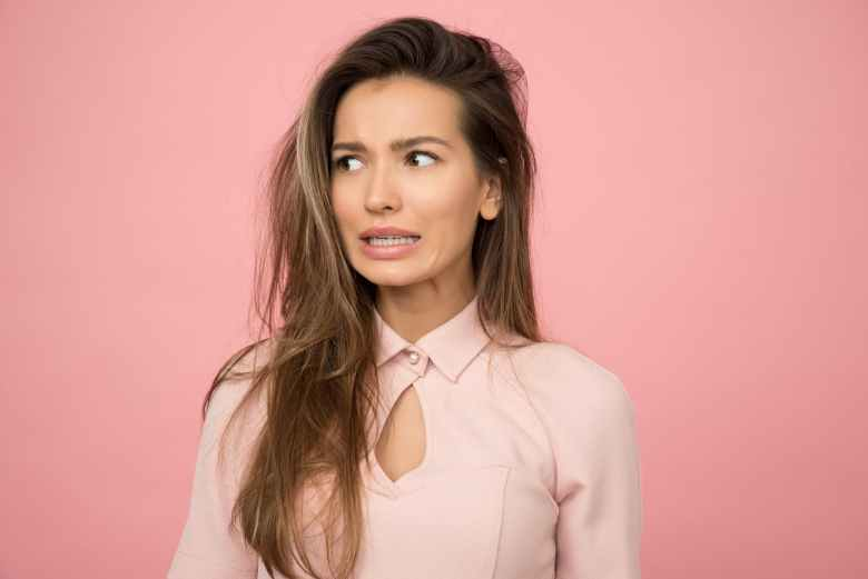 woman wearing pink top