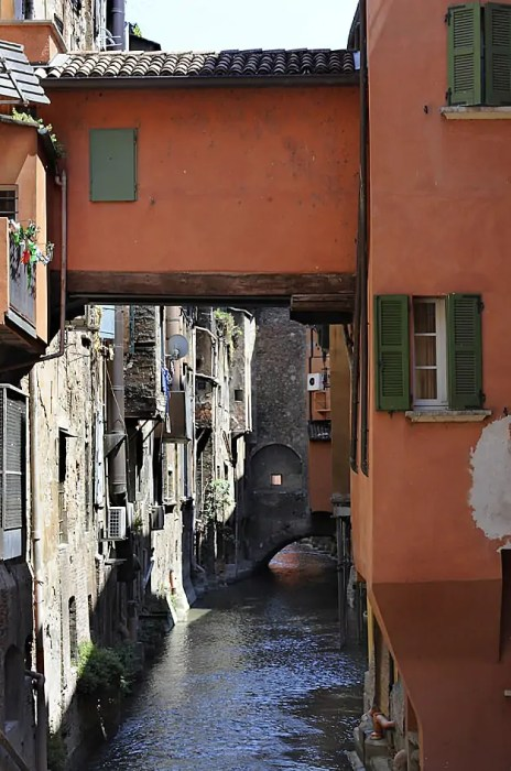 Looking back at the hole in the wall, over one of Bologna secret canals