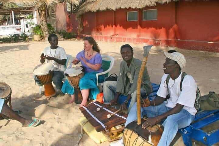 Things to do in The Gambia - drumming lesson on the beach
