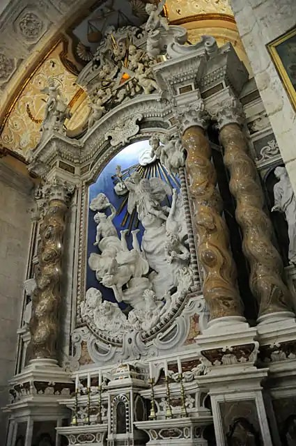 Sculpture of devils being cast in to hell by San Michelle