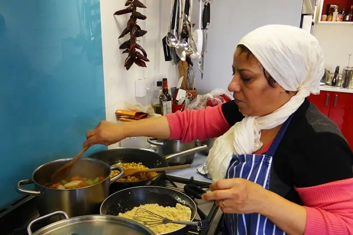 Refugee Action - our refugee chef Mahin prepares one of the delicious dishes