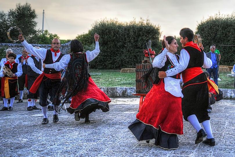 Traditional costumes of dancers at Grape Harvest Festival, Locorotondo, Puglia, Italy