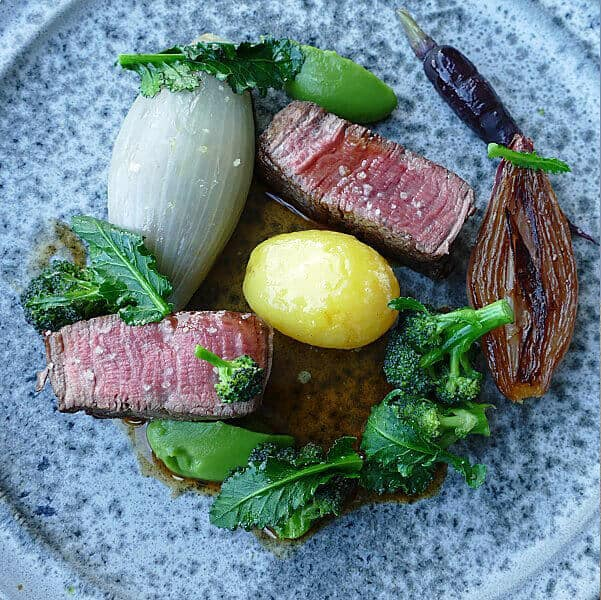 OX | Ssucculent chateaubriand served with ox tongue, sprouting broccoli and a smoked potato – a wonderful mix of rich and earthy flavours. from one of the best restaurants in Belfast