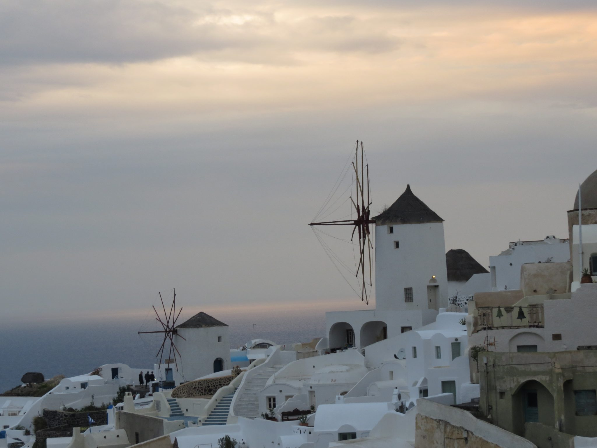 Oia Sunset with traditional windmills and white houses