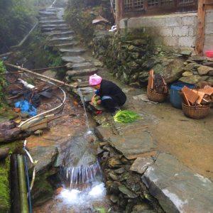 Local woman washing vegetables in Ping'An, Longsheng, Guanxi, China © Travelwithmk.com