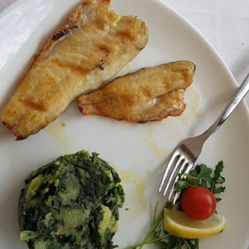 Grilled fish with spinach and crab meat