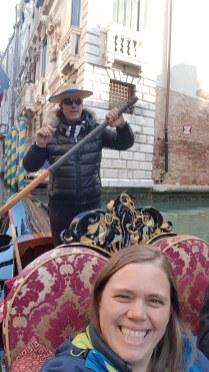 Enjoying the gondola in Venice