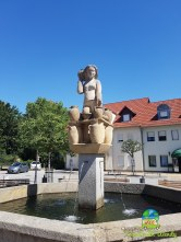 Fountains in town, lady with pottery