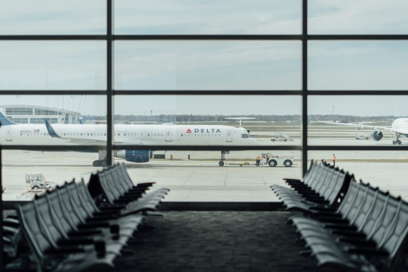 Delta plane taxiing outside terminal