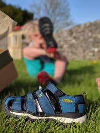 Childs sandal and child