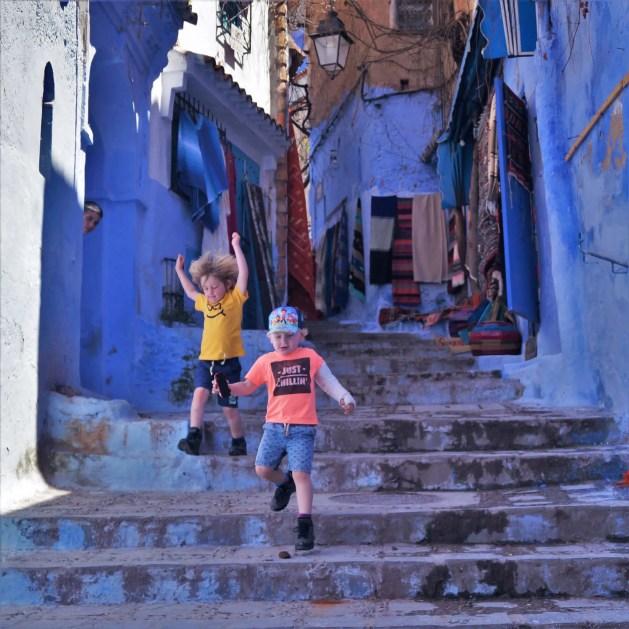 two boys walking down steps in medina