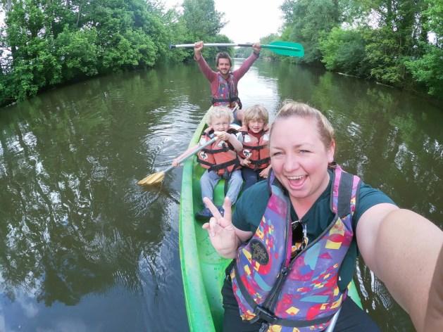 family in kayak on river