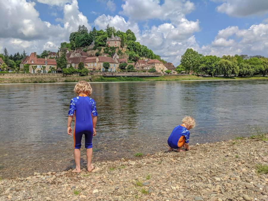 two boys by river