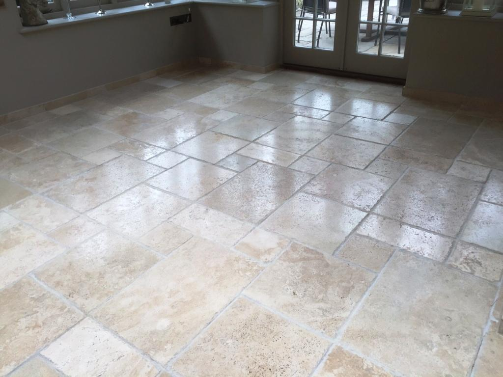 polishing a pitted travertine tiled