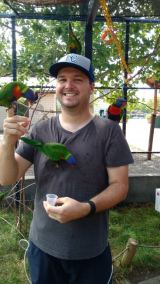 Travis Pflanz with the lorikeets at the Kansas City Zoo