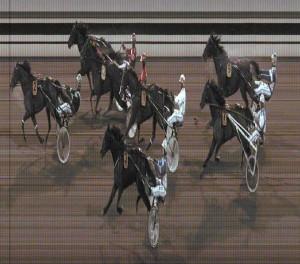 Quantum Doubleleap med Johnny Takter vandt sin sidste start fra Flemming Jensens stald i et tæt opløb