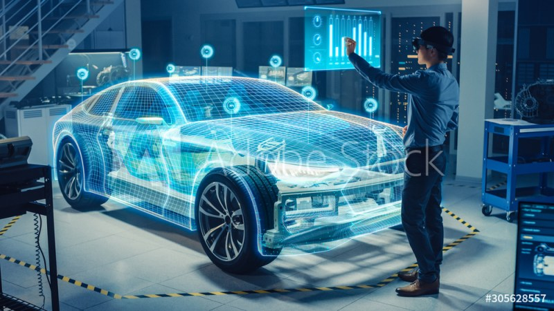 Automotive Engineer Use Virtual Reality Headset for Virtual Electric Car 3D Model Design Analysis and Improvement. 3D Graphics Visualization Shows Fully Developed Vehicle Prototype Analysed Optimized