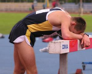 Athlete with the agony of defeat
