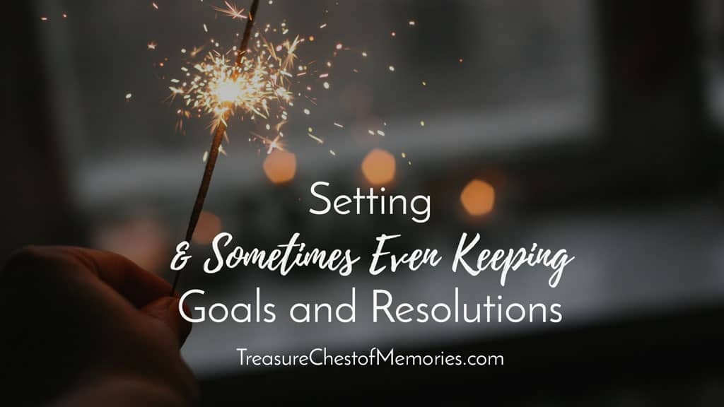 Setting and sometimes even keeping Goals and Resolutions Graphic with sparklers in background