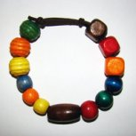 Bracelet     Size Medium/Adult Female 3.5 in to 4.25 in Made with Leather Cord and 13 Wood Beads Price: $5.00
