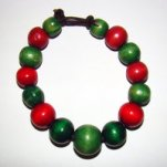 Bracelet     Size   Medium/Adult Female   3.5 in to 4 in Made with Leather Cord and 15 Wood Beads Price: $5.00