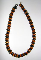 Necklace   Size  Medium/Adult   9 in Made with Leather Cord and 70 Wood Beads Price: $10.00