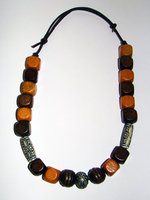 Necklace     Size   Small/Adult   8.5 in to 10.5 in Made with Leather Cord, 18 Wood Beads and 3 Plastic Beads Price: $7.00