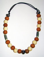 Necklace     Small Adult   9.5 in to 11. 5 in Made with Leather Cord, 20 Wood Beads and 5 Plastic Beads Price: $7.00