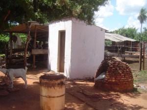 The outhouse bathroom next to the brick oven (tatakua).