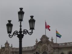 The Peruvian flag and the Inca flag flying above the Government Palace of Peru or the Palacio de Gobierno in Plaza Mayor in Lima, Peru.