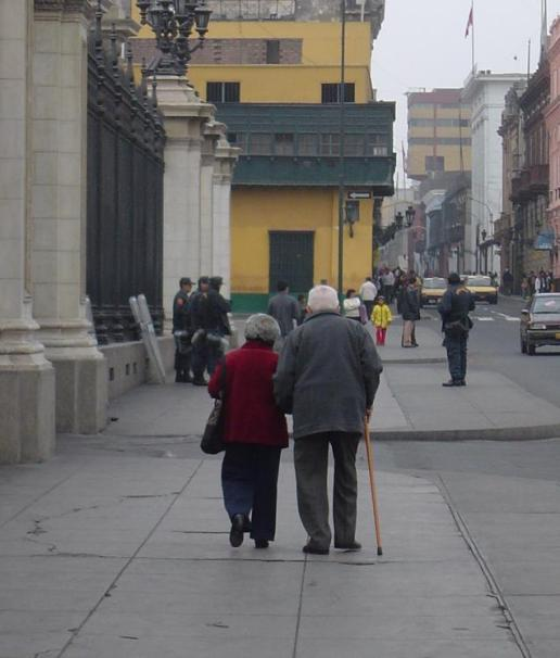 Older Peruvian couple walking hand in hand down the street in Lima, Peru.