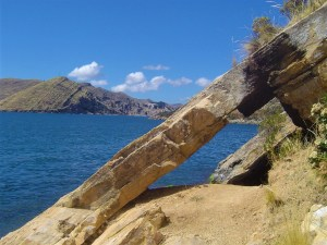 A view of Lake Titicaca through a rock formation on Isla del Sol.