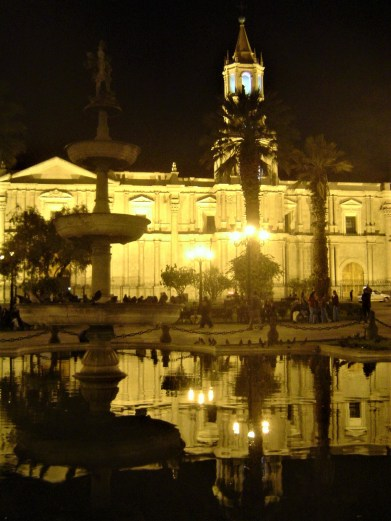 The Cathedral of Arequipa illuminated by glowing lights in the evening.