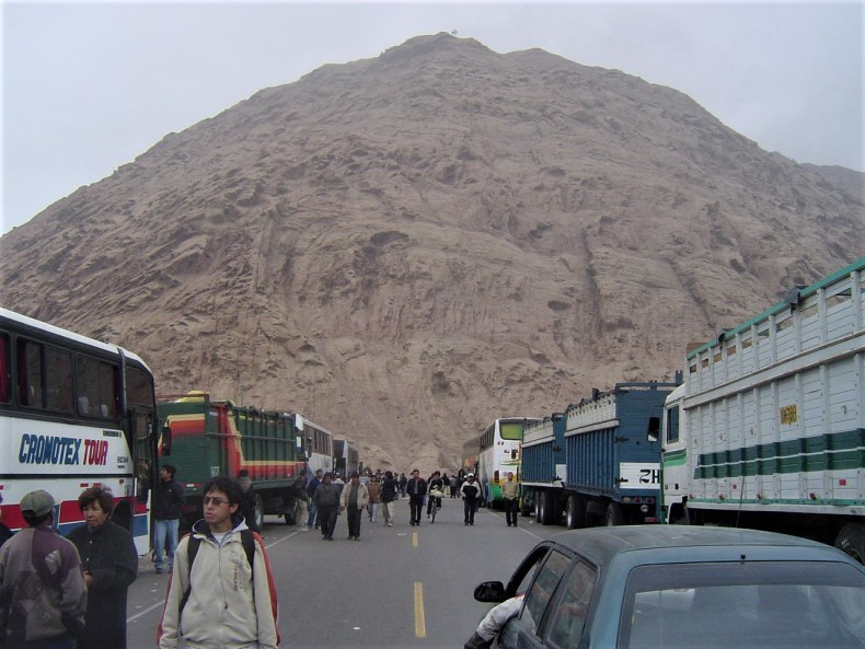 The hundreds of buses and trucks stranded along the side of the Pan-American Highway in Peru waiting for the rock slide to be cleared.