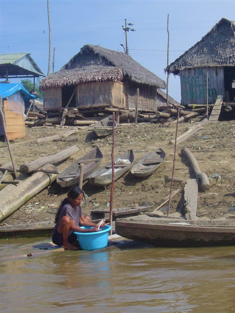 The district of Belen with its ramshackle houses. Here a women washing her clothes.