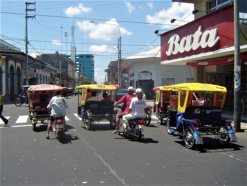 Rickshaws, Mototaxis, Motocarros or Tuk-Tuks in Iquitos.