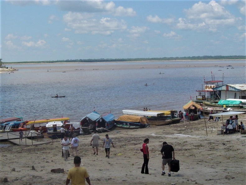 People getting ready to take water taxis or boats to their destination.